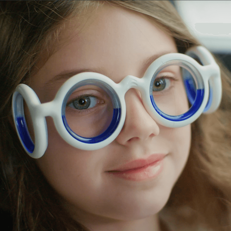child wearing motion-sickness aid glasses